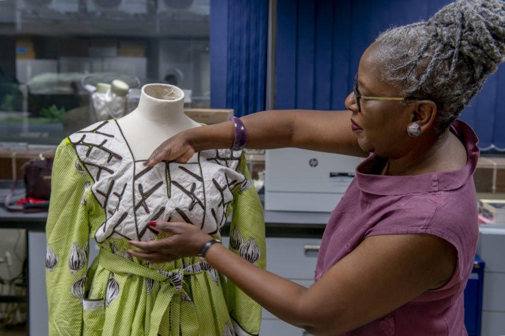 Iyamide Thomas setting up a Krio Dress